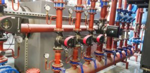 Air Plants Heating & Cooling (image of red pipes)